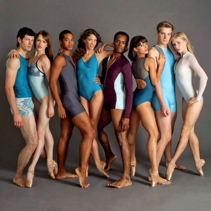 group of men and women in leotards